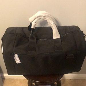 0a6024009501 MICHAEL Michael Kors Bags - Michael Kors Travis duffel w  strap